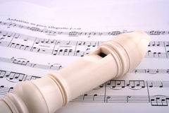 Recorder on sheet music Stock Photo