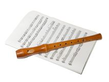 Recorder on a sheet music. A soprano recorder on a sheet music Stock Photos