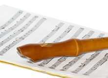 Recorder on a sheet music. A soprano recorder on a sheet music Stock Images
