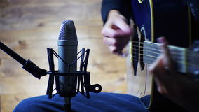 Recording Acoustic Guitar In The Studio stock video footage