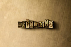 RECORDING - close-up of grungy vintage typeset word on metal backdrop Stock Photos