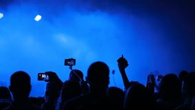 Recording a concert with mobile phone stock video footage