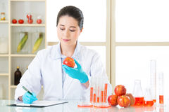 Recording data of test result from Examining genetic modification. In laboratory stock photography