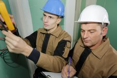 Recording electrical status building Stock Photography