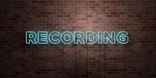 RECORDING - fluorescent Neon tube Sign on brickwork - Front view - 3D rendered royalty free stock picture. Can be used for online banner ads and direct mailers Stock Image
