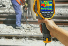 Recording with Infrared camera Two Workers Royalty Free Stock Photos