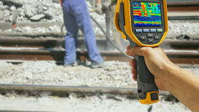 Recording with Infrared camera Two Workers. With pneumatic hammer breaking Concrete at construction site, 4K video stock footage