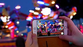 Recording people playing carnival rides stock video footage