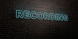 RECORDING -Realistic Neon Sign on Brick Wall background - 3D rendered royalty free stock image. Can be used for online banner ads and direct mailers Stock Images