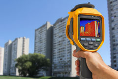 Recording Residential Buildings With Thermal Camera. Recording Heat Loss at the Residential Building With Infrared Thermal Camera Stock Images