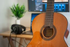 Recording room Singing concept. Guitarists are playing pop music on guitar royalty free stock photo