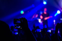 Recording the show. Person recording a concert on their smart phone Royalty Free Stock Photography