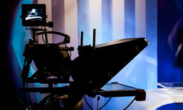 Recording show in TV studio. Video camera lens - recording show in TV studio - focus on camera stock image