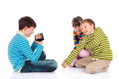 Recording siblings fun Stock Images