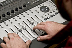 Recording Studio. View of a man working the audio recording equipment in a music recording studio Royalty Free Stock Photo