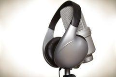 Recording studio. Recording microphone and studio headphones on metallic background Stock Image