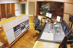 Recording studio. A shot of a recording studio, complete with technition, lights and equipment royalty free stock photo