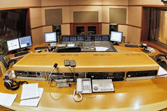 Recording studio. A shot of a recording studio, complete with technition, lights and equipment Stock Images