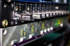 Recording studio gears. In rack close up. Selective focus Royalty Free Stock Photo