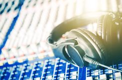 Recording Studio Headphones. On the Audio Mixer Board. Closeup Photo. Music and Show Business Concept royalty free stock image