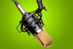 Recording Studio Microphone. Closeup of a condenser recording studio microphone. Taken against fresh green background stock photos
