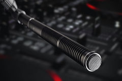 Recording studio microphone. Studio microphone in front of mixing console in recording studio Royalty Free Stock Photos