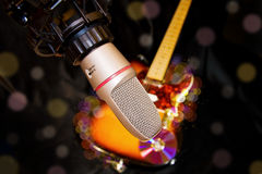 Recording studio microphone over electric guitar Royalty Free Stock Images