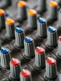 Recording studio mixer knobs. Macro photo of the knobs of a recording studio soundboard Royalty Free Stock Photos