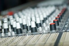 Recording studio mixing board. Close up recording studio mixing board with shalloe depth of field Royalty Free Stock Image