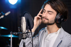 Recording Studio. Portrait of young man recording a song in a professional studio Royalty Free Stock Photos