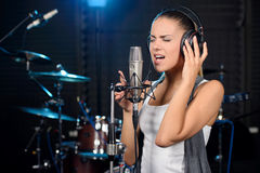 Recording Studio. Portrait of young woman recording a song in a professional studio Stock Photography