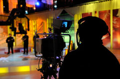 Recording TV show in studio. Cameraman works in the studio - recording show in TV studio stock images