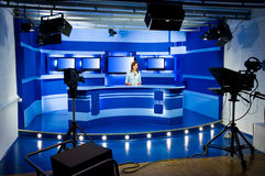 Recording at TV studio. With television anchorwoman stock photos