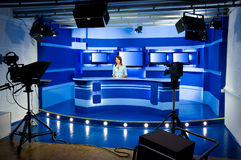 Recording at TV studio. With television anchorwoman Royalty Free Stock Photos