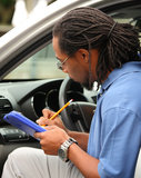 Recording Vehicle Mileage. An estimator records vehicle mileage Royalty Free Stock Photo