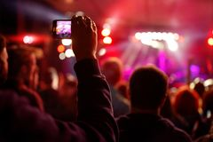 Recording video with smartphone during a concert- summer music f royalty free stock photos