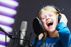 Regording studio. Child girl singing or role voicing Royalty Free Stock Images