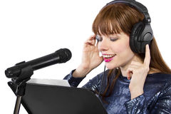 Recording Voice Overs or Singing. Woman singing or reading a script for voice over Royalty Free Stock Photo