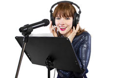 Recording Voice Overs or Singing. Woman singing or reading a script for voice over Stock Image