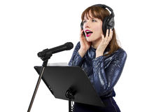 Recording Voice Overs or Singing. Woman singing or reading a script for voice over Stock Photography