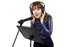 Recording Voice Overs or Singing. Woman singing or reading a script for voice over Stock Images