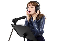 Recording Voice Overs or Singing. Woman singing or reading a script for voice over Royalty Free Stock Photography