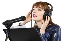 Recording Voice Overs or Singing. Woman singing or reading a script for voice over Stock Photos