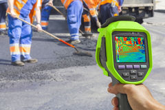 Recording Workers With Infrared Thermal Camera. Recording Workers on Asphalting and Repair of roads With Infrared Thermal Camera Stock Photography
