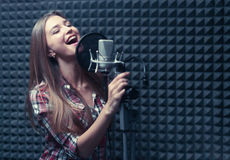 Recording. Young singer in a recording studio Royalty Free Stock Photography
