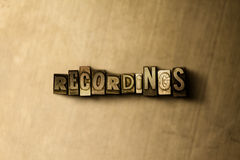 RECORDINGS - close-up of grungy vintage typeset word on metal backdrop Royalty Free Stock Photos