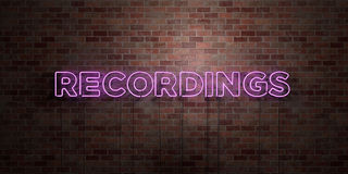 RECORDINGS - fluorescent Neon tube Sign on brickwork - Front view - 3D rendered royalty free stock picture Stock Image