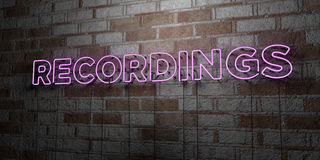 RECORDINGS - Glowing Neon Sign on stonework wall - 3D rendered royalty free stock illustration Royalty Free Stock Image