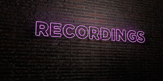 RECORDINGS -Realistic Neon Sign on Brick Wall background - 3D rendered royalty free stock image Royalty Free Stock Image