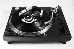 Recordplayer with record. Recordplayer with black record and headphones on top Royalty Free Stock Photo